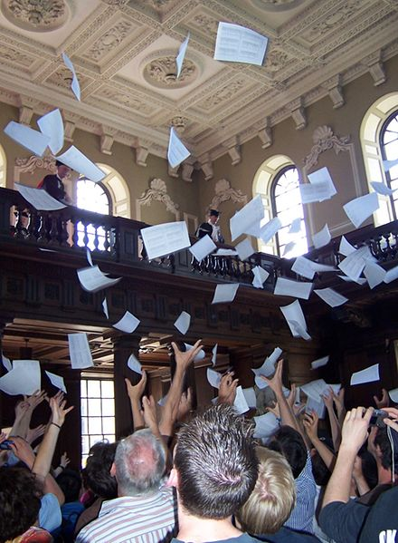Results are read out at the Senate House and then tossed from the balcony. [Photograph from http://en.wikipedia.org/wiki/File:Mathmo_results.jpg]