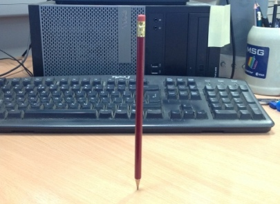 A pencil balanced on its point. Is there a trick? Yes: see below.