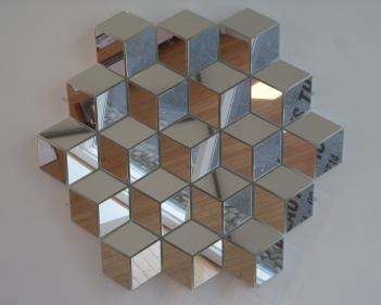 Oscillator, an ingenious assembly of angled rhomboidal mirrors by Suresh Dutt.