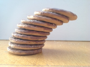 Ten chocolate gold grain biscuits, with a hangover of about one diameter.