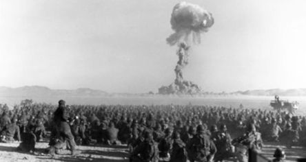 US army soldiers watching the first test of an atomic weapon, the Trinity Test.