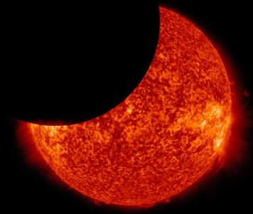 Moon between NASA's Solar Dynamics Observatory and the Sun, giving a partial solar eclipse from space on Jan. 30, 2014. Image NASA.